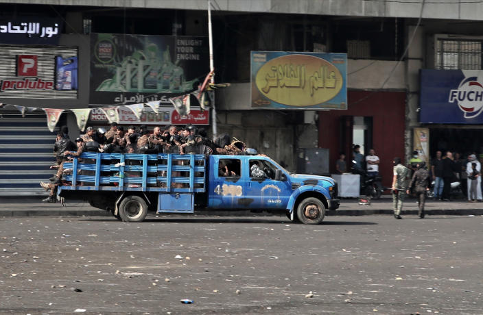 Police reinforcements arrive during clashes between Iraqi security forces and anti-government protesters in downtown Baghdad, Iraq, Sunday, Nov. 10, 2019. On Sunday, Amnesty International called on Iraqi authorities to immediately rein in security forces after at least six protesters were killed Saturday in central Baghdad amid a widening security crackdown. (AP Photo/Khalid Mohammed)