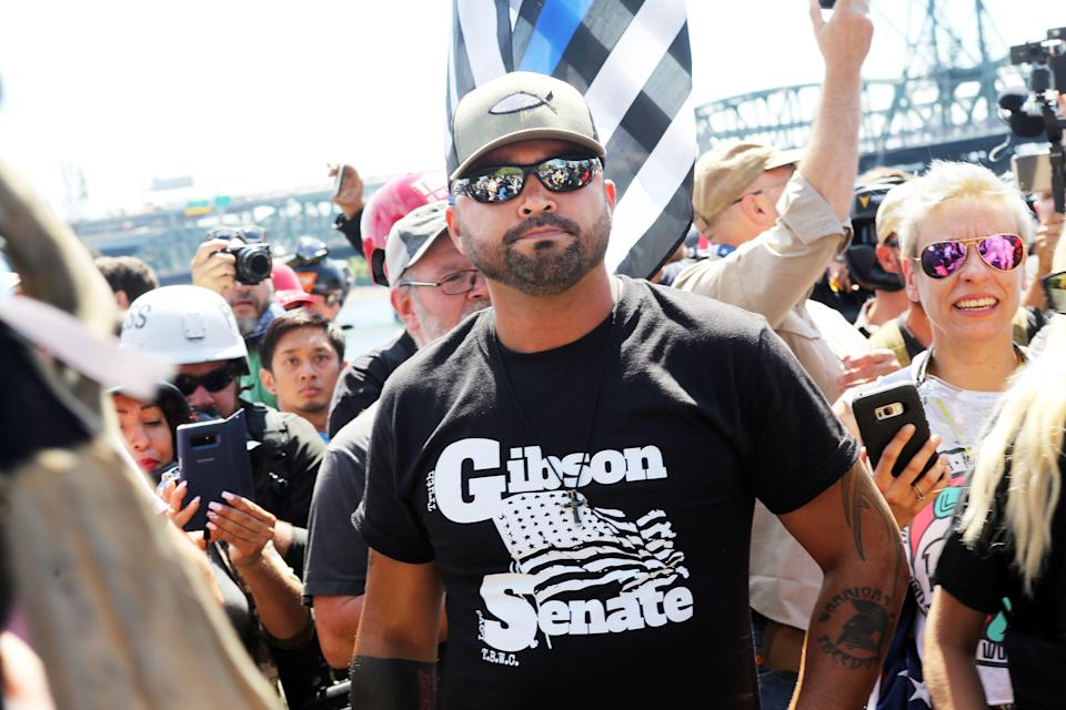 <p>Rally organizer, Patriot Prayer founder and Republican Senate candidate Joey Gibson stands with alt-right activists in Portland, Ore., Aug. 4, 2018. (Photo: Thomas Patterson/AFP/Getty Images) </p>