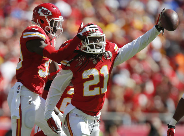 Kansas City Chiefs cornerback Dunta Robinson (21) celebrates a fumble recovery with defensive back Husain Abdullah (39) during the first half of an NFL football game against the New York Giants at Arrowhead Stadium in Kansas City, Mo., Sunday, Sept. 29, 2013. (AP Photo/Ed Zurga)