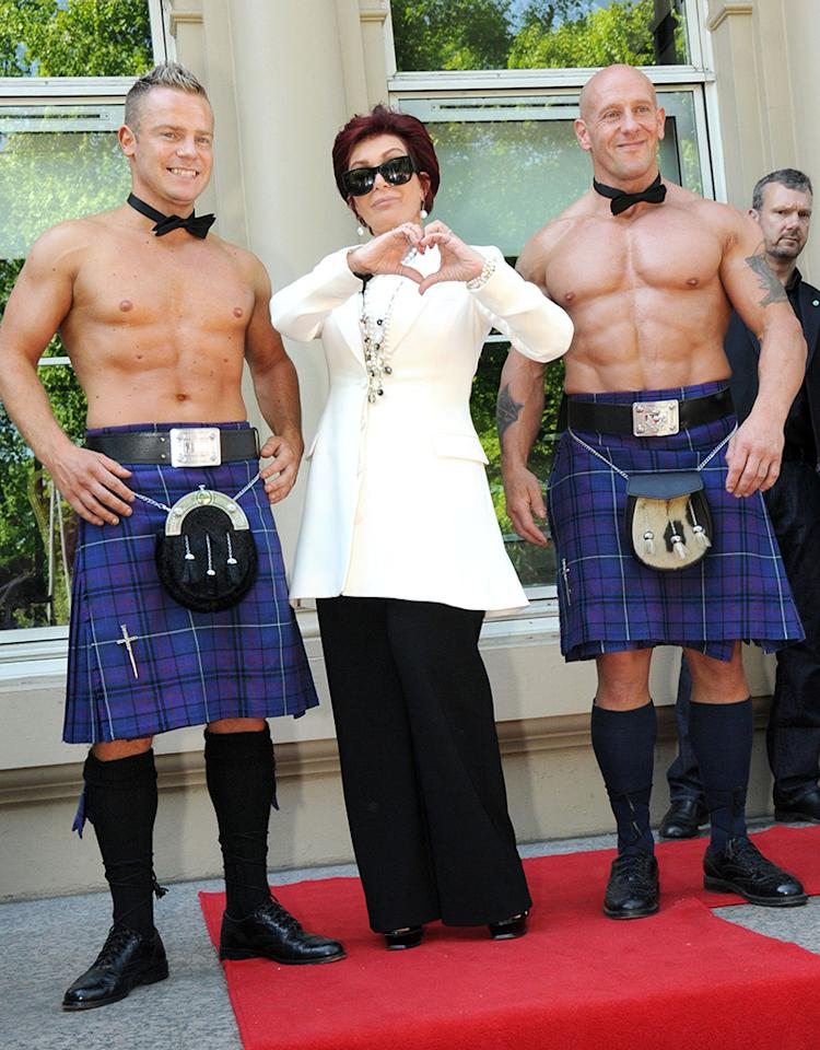"It's love! The British version of ""The X Factor"" judge Sharon Osbourne found herself in the middle of a hunky Scottish sandwich on her way in to auditions in Glasgow on Tuesday. (6/4/2013)"