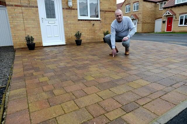John Twidale outside of his Whistlewood Close home. See Ross Parry story RPYPAVE: A homeowner has been threatened with court action after he paved over his front garden. John Twidale, 60, replaced the turf outside the front of his home in Whistlewood Close, Hartlepool. Mr Twidale bought the home on a new development off Tanfield Road from Gleeson Developments about two and a half years ago. Around a year ago he decided to replace the grass at the front of his home with block paving at a cost of about £2,000 because other residents had done the same. He also thought it looked tidier and would be easier to maintain as he has problems with his legs. But now Mr Twidale has been told by the developer the work is not allowed and warned he will be taken to court if he does not reinstate the lawn by February 28.