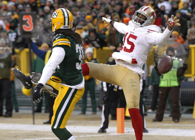 Green Bay Packers cornerback Davon House (31) breaks up a pass intended for San Francisco 49ers wide receiver Michael Crabtree (15) during the first half of an NFL wild-card playoff football game, Sunday, Jan. 5, 2014, in Green Bay, Wis. (AP Photo/Mike Roemer)