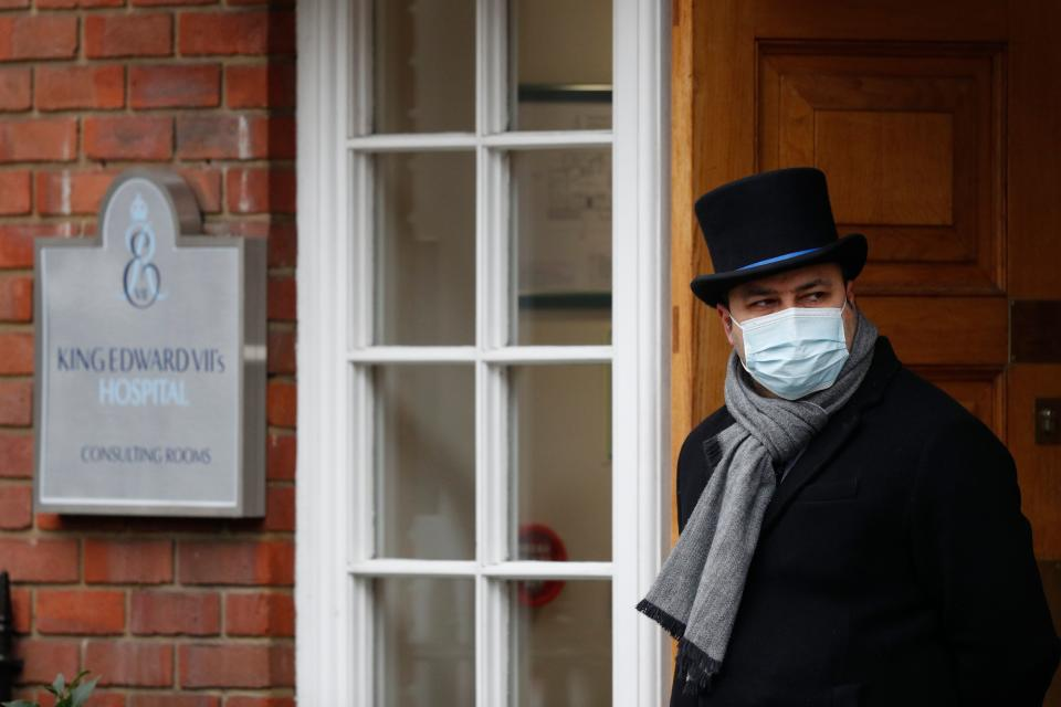 A doorman looks out from the entrance to King Edward VII hospital in central London on February 22, 2021 where Britain's Prince Philip, Duke of Edinburgh remains after being admitted on February 16. (Photo by Adrian DENNIS / AFP) (Photo by ADRIAN DENNIS/AFP via Getty Images)