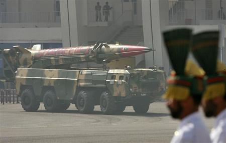 Pakistan's nuclear-capable missile, Shaheen 1, is driven past with its mobile launcher during the National Day military parade in Islamabad March 23, 2008. REUTERS/Mian Khursheed/Files
