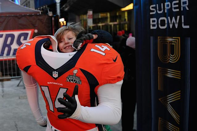 NEW YORK, NY - JANUARY 29: Win Nangle, 6, of New York, poses in a Denver Broncos uniform on Super Bowl Boulevard on January 29, 2014 in New York, New York. In preparation for the Super Bowl sections of Times Square and Broadway host various games, sponsor booths, and TV broadcasts. (Photo by Maddie Meyer/Getty Images)