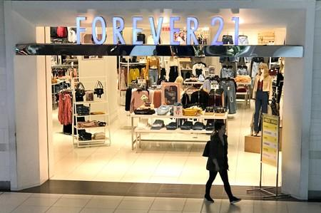 A shopper walks from a Forever 21 fashion retail store in downtown Toronto