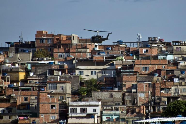 The helicopters tend to fly low over the favela -- in the first half of 2019, helicopters were used in eight of 21 police operations in Rio's Mare slum complex (AFP Photo/VANDERLEI ALMEIDA)