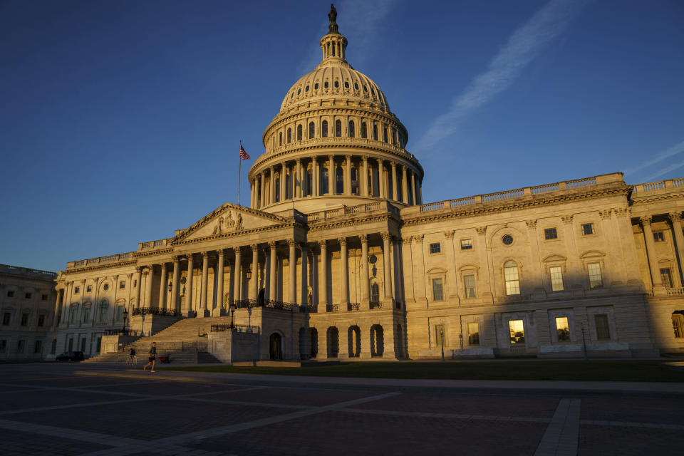 """The Capitol is seen at dawn as a consequential week begins in Washington for President Joe Biden and Democratic leaders in Congress who are trying to advance his $3.5 trillion """"Build Back Better"""" and pass legislation to avoid a federal shutdown, Monday, Sept. 27, 2021. (AP Photo/J. Scott Applewhite)"""