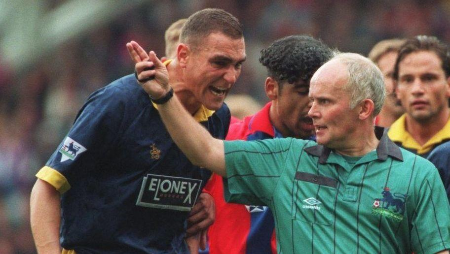 <p>'Crazy Gang' leader Vinnie Jones was slapped with a six month ban, suspended for three years, when the FA found the Wimbledon hard man guilty of bringing the game into disrepute for his part in the video 'Soccer Hard Men'.</p> <br /><p>Seen as celebrating violence with his voice-overs, Jones was also fined £20,000.</p>