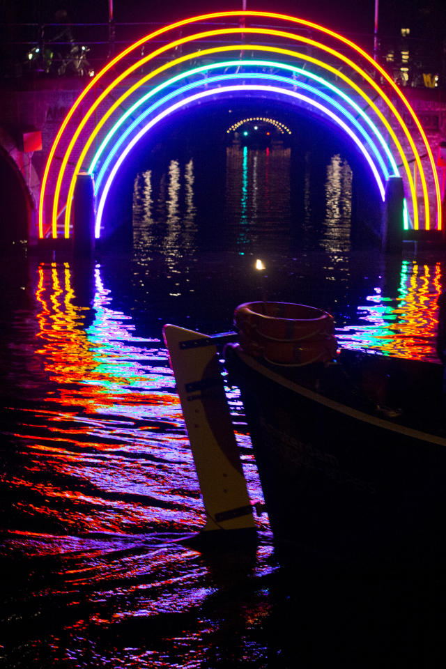 "<p> A boat passes ""Bridge of the Rainbow"", an art work by French light designer Gilbert Moity, part of the Amsterdam Light Festival, Netherlands, Wednesday, Nov. 30, 2016. The festival opens on Dec. 1, 2016, and ends on Jan. 22, 2017, the artworks are lit from 17:00 until 23:00, and for the Illuminade, a walking route, between 17:00 and 22:00 Central European Time. (AP Photo/Peter Dejong) </p>"