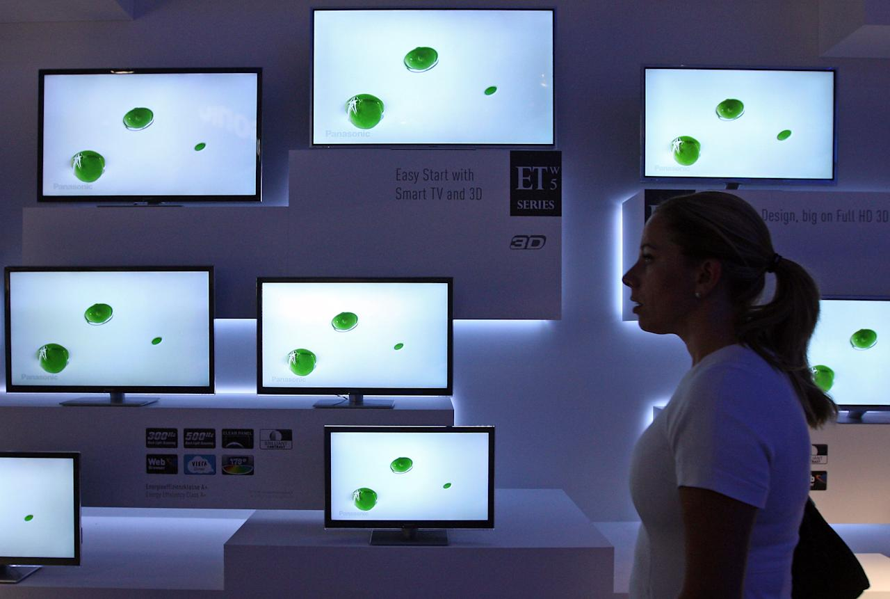 BERLIN, GERMANY - AUGUST 31:  A visitor passes Panasonic ETW5 energy efficient Smart TV flat-screen televisions at the Internationale Funkausstellung (IFA) 2012 consumer electronics trade fair on August 31, 2012 in Berlin, Germany. IFA 2012 is open to the public from today until September 5.  (Photo by Adam Berry/Getty Images)