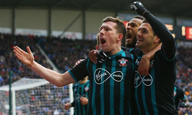 Southampton's Pierre-Emile H<em>ø</em>jbjerg celebrates his goal with Dusan Tadic and Ryan Bertrand at DW Stadium on Sunday.