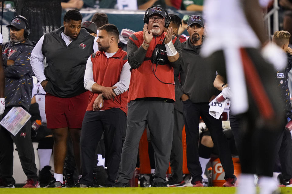 Tampa Bay Buccaneers head coach Bruce Arians claps during the first half of an NFL football game against the Philadelphia Eagles on Thursday, Oct. 14, 2021, in Philadelphia. (AP Photo/Matt Slocum)