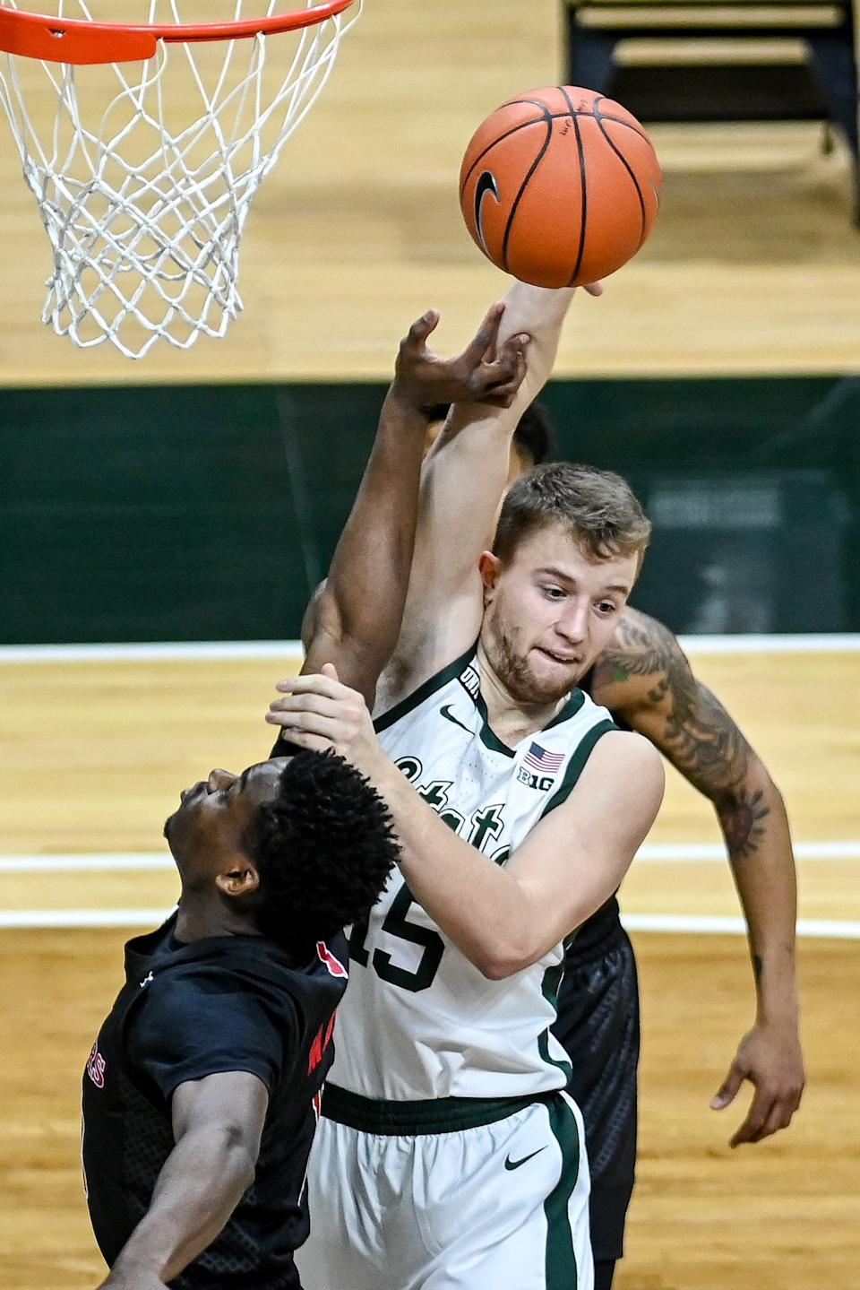 Michigan State's Thomas Kithier, right, goes for a rebound along with Rutgers' Montez Mathis during the first half on Tuesday, Jan. 5, 2021, at the Breslin Center in East Lansing.