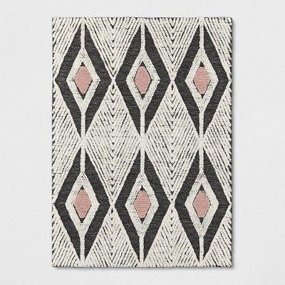 "<p>Woven from hand-tufted wool, this light-hued and geometric-patterned rug gives off vibes of understated bohemian elegance.</p><br><br><strong>Project 62</strong> Tufted Area Rug (5X7), $152.99, available at <a href=""https://www.target.com/p/pink-cream-gray-tufted-area-rug-project-62-153/-/A-53405604"" rel=""nofollow noopener"" target=""_blank"" data-ylk=""slk:Target"" class=""link rapid-noclick-resp"">Target</a>"