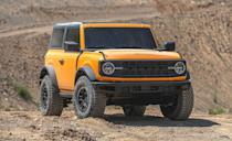 "<p>Your prayers have been answered; the <a href=""https://www.caranddriver.com/ford/bronco"" rel=""nofollow noopener"" target=""_blank"" data-ylk=""slk:Ford Bronco"" class=""link rapid-noclick-resp"">Ford Bronco</a> is back in a big way. It's offered in two- or four-door layouts, with a new 7-speed manual transmission, optional 35-inch tires, a removable top and doors, and an infotainment that can download trail maps and navigate them without any WiFi or cell service. The body-mounted mirrors mean taking the doors off won't cost you much, and a pull-out table is also an option for the rear area. A 270-hp 2.3-liter EcoBoost four-cylinder or a 2.7-liter EcoBoost V-6 with a claimed 310 horsepower. There's no V-8 option, just turbos. Both body styles have a 3500-lb towing capacity. Ford is currently taking $100 refundable deposits, and the Ford Bronco is expected to go on sale Spring 2021.</p>"