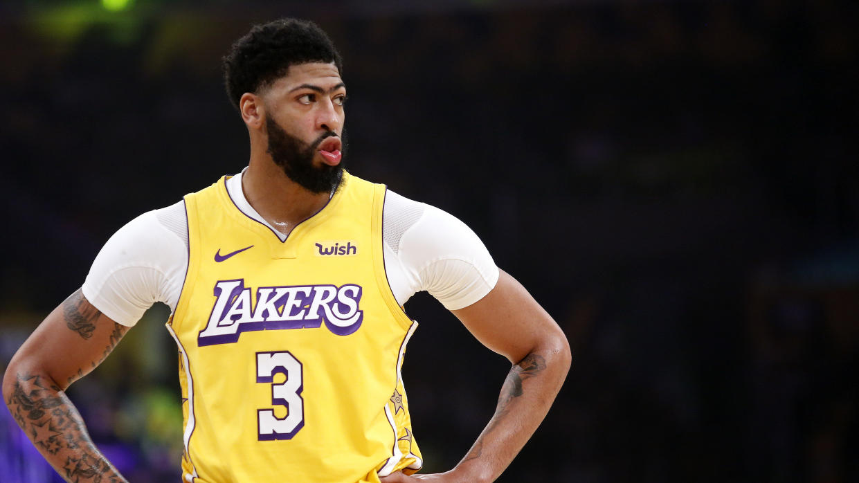 Los Angeles Lakers' Anthony Davis (3) reacts during an NBA basketball game between Los Angeles Lakers and Los Angeles Clippers, Wednesday, Dec. 25, 2019, in Los Angeles. The Clippers won 111-106. (AP Photo/Ringo H.W. Chiu)