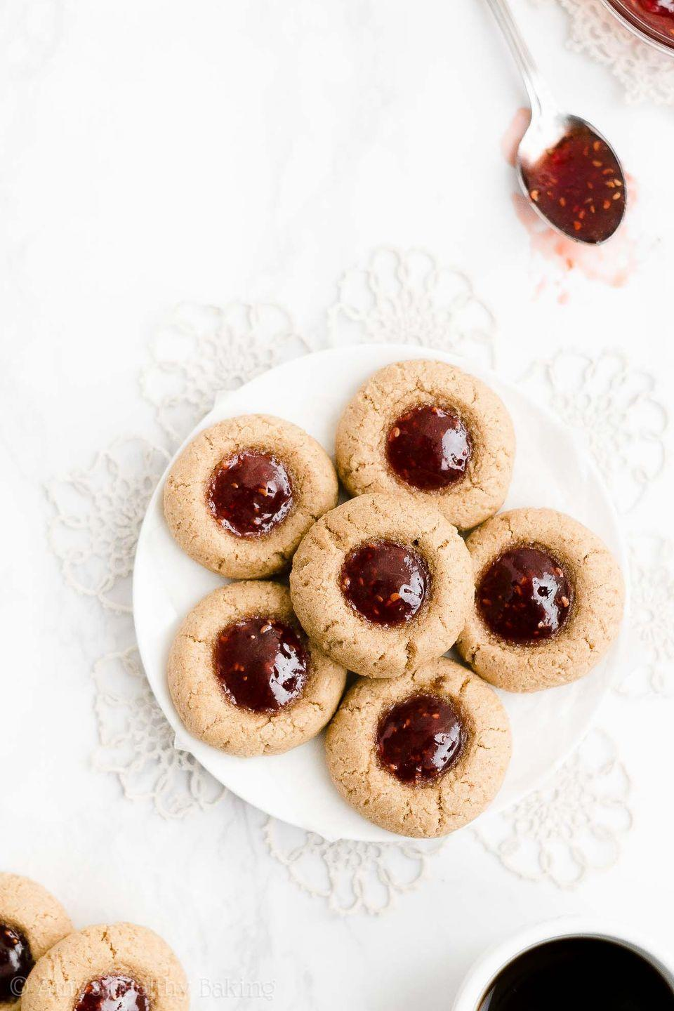 """<p>These fruit-filled cookies are made with fiber-packed white whole wheat flour (a healthier alternative to all-purpose flour). To cut down on sugar, use a sugar-free jam. </p><p><strong>Get the recipe at <a href=""""https://amyshealthybaking.com/blog/2019/12/11/healthy-spiced-thumbprint-cookies/"""" rel=""""nofollow noopener"""" target=""""_blank"""" data-ylk=""""slk:Amy's Healthy Baking"""" class=""""link rapid-noclick-resp"""">Amy's Healthy Baking</a>. </strong></p>"""