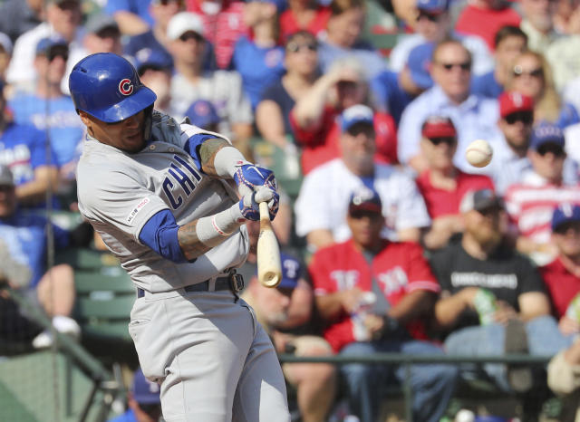 Chicago Cubs' Javier Baez (9) hits a three-run home run against the Texas Rangers in the fifth inning of a baseball game Thursday, March 28, 2019, in Arlington, Texas. (AP Photo/ Richard W. Rodriguez)