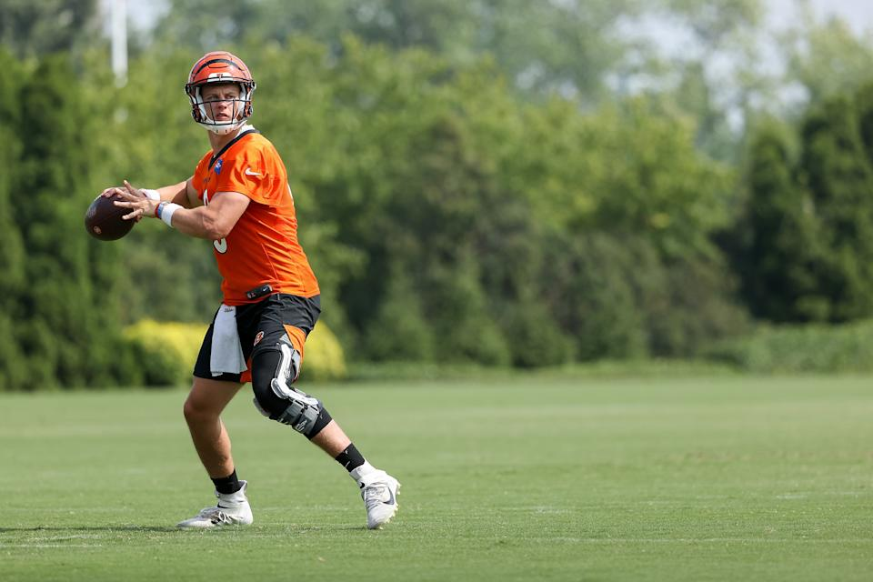 CINCINNATI, OHIO - JULY 30: Joe Burrow #9 of the Cincinnati Bengals throws a pass during training camp on July 30, 2021 in Cincinnati, Ohio. (Photo by Dylan Buell/Getty Images)