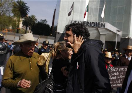Andres Manuel Lopez Beltran, the son of leftist leader Andres Manuel Lopez Obrador, is greeted by a supporter during a protest against an energy reform bill at the Senate building in Mexico City December 4, 2013. REUTERS/Tomas Bravo