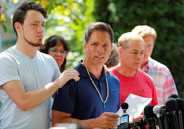<p>Don Damond is comforted by his son Zach Damond as he speaks to the media about his fiance, Justine Damond who was fatally shot by Minneapolis police in Minneapolis, Minnesota, July 17, 2017. (Photo: Adam Bettcher/Reuters) </p>