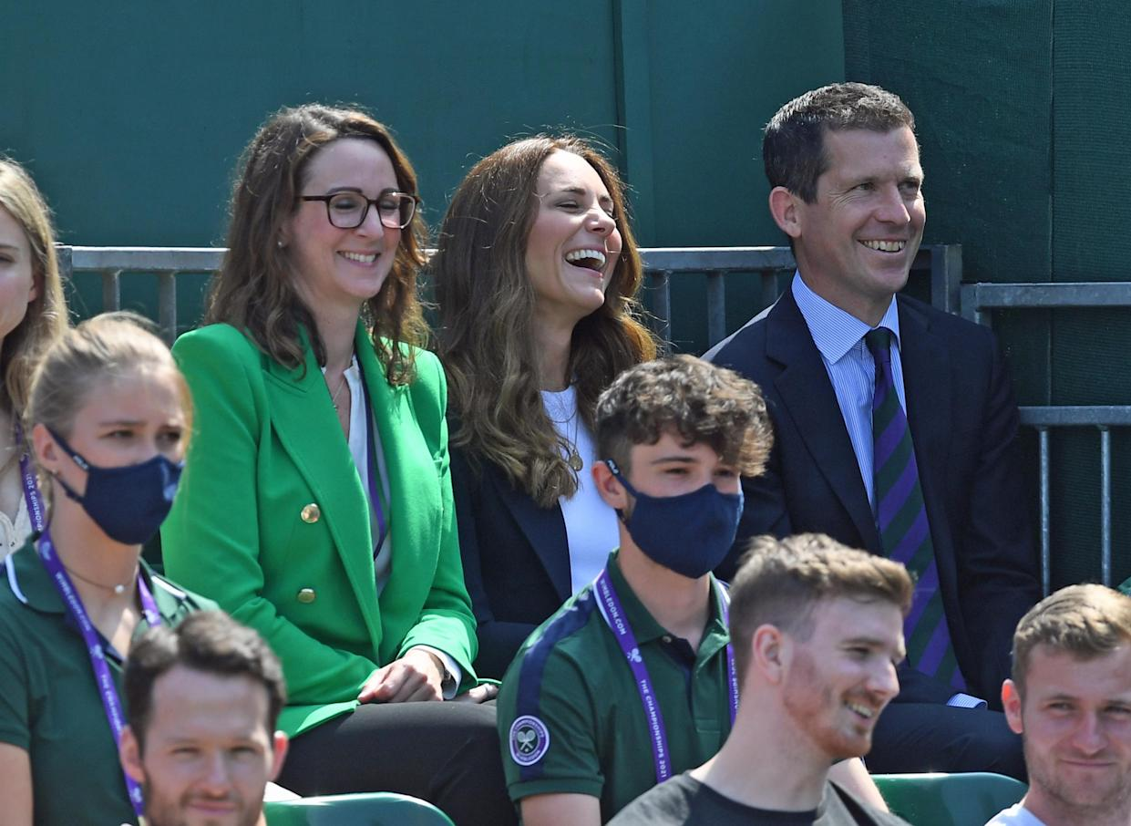 The Duchess of Cambridge (centre) and Tim Henman (right) attending day five of Wimbledon at The All England Lawn Tennis and Croquet Club, Wimbledon.