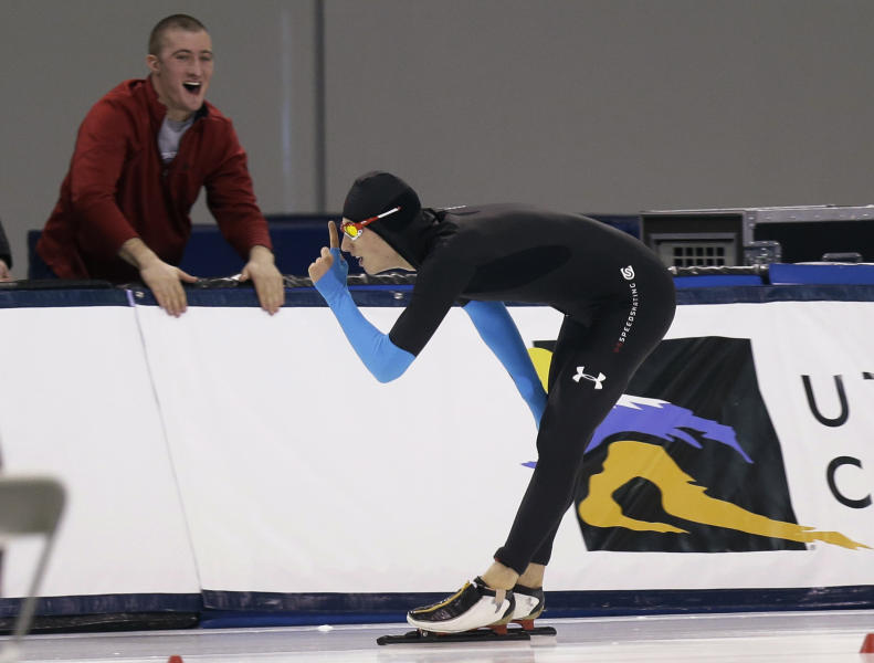 Emery Lehman celebrates after competing in the men's 10,000 meters during the U.S. Olympic speedskating trials Wednesday, Jan. 1, 2014, in Kearns, Utah. Lehman won the event. (AP Photo/Rick Bowmer)