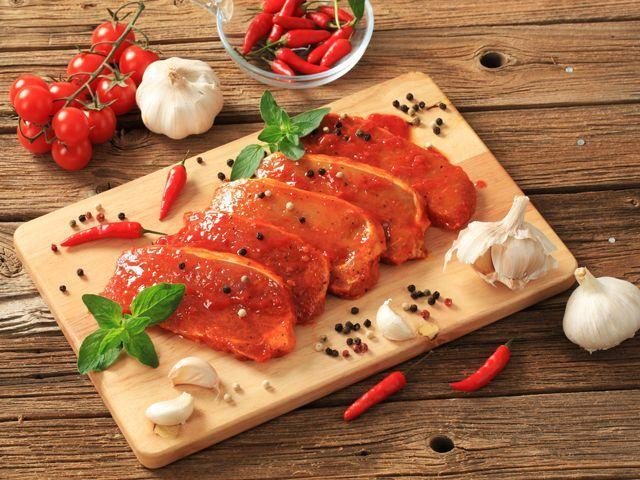 <p>Marinate inexpensive cuts of meat in at least one of the following: beer; vinegar; or citrus, papaya, tomato, or pineapple juices. These liquids contain enzymes or acids that will combat the meat's toughness.</p>