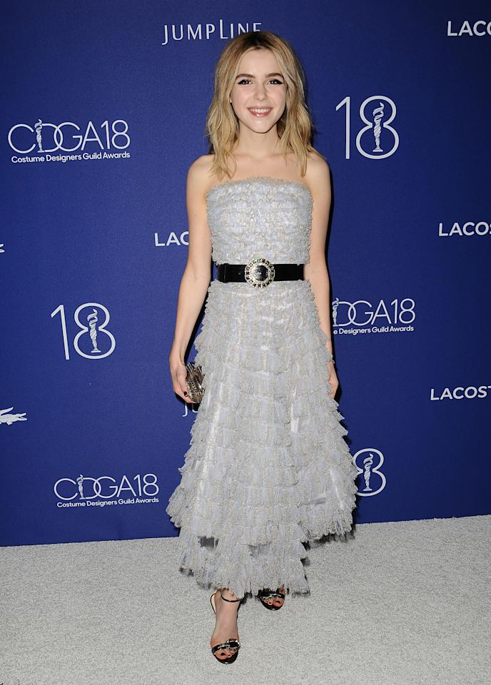 """<p>The 16-year-old actress helped honor Janie Bryant's fashionable work on """"Mad Men,""""wearing a frilly silver frock from Alexander McQueen's Resort 2016 collection.<i> </i>(Getty Images)</p>"""