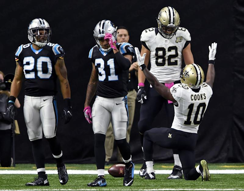 New Orleans Saints receiver Brandin Cooks, No. 10, changed up his bow-and-arrow celebration on Sunday. (AP)