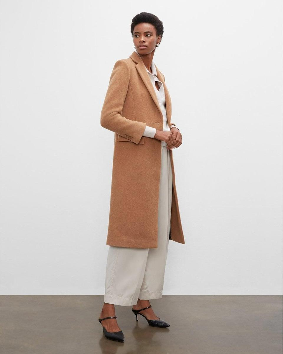 <p>The construction of this <span>Club Monaco Slim Tailored Coat</span> ($479) gives it a serious air, so you know you'll look professional when you put it on. Wear it to your first day back at the office.</p>