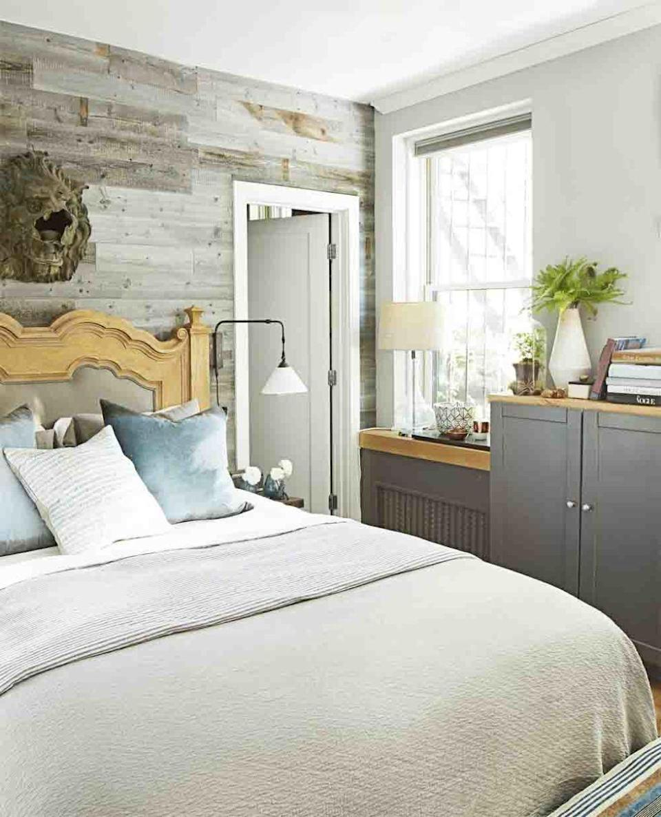 <p>Play up a bedroom's rustic flair with a wood paneled wall in varying shades of gray. </p>