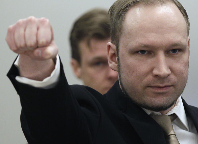 FILE This Monday, April 16, 2012 file photo shows  Anders Behring Breivik gesturing as he arrives at the courtroom in Oslo, Norway. Mass murderer Anders Behring Breivik's shocking testimony to a Norwegian court has revived a debate about how much of a public platform mass-murderers should be given in trials. Such atrocities are often waged for attention and carried out in the name of political or religious goals, and a trial gives perpetrators more of what they crave: a huge audience. (AP Photo/Frank Augstein)