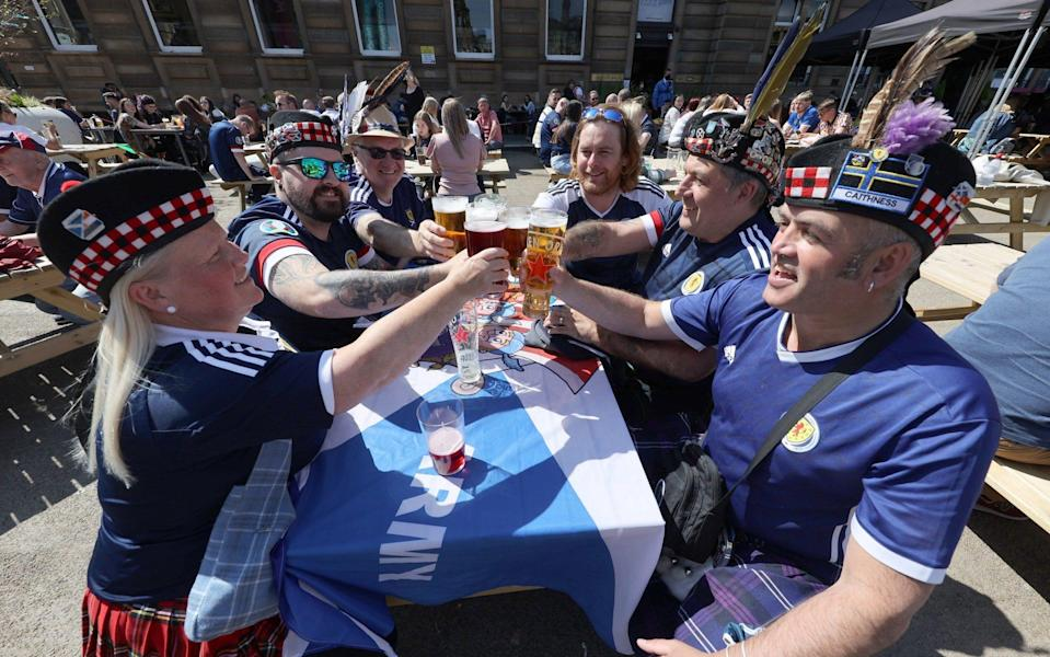 Scotland fans in St George's Square, Glasgow. Picture date: Tuesday June 22, 2021. PA Photo. See PA story SOCCER Scotland. Photo credit should read: Steve Welsh/PA Wire - PA