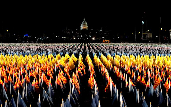 """The """"Field of Flags"""" is being used to represent the American public, who are not able to attend the inauguration due to security concerns and the coronavirus pandemic - TIMOTHY A. CLARY/AFP"""