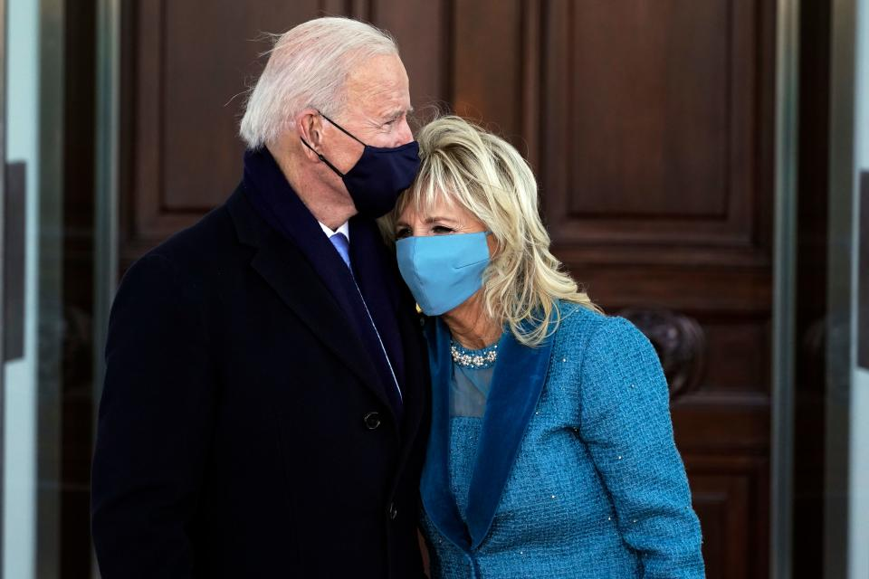 US President Joe Biden (C L) hugs First Lady Jill Biden as they arrive at the White House in Washington, DC, on January 20, 2021.