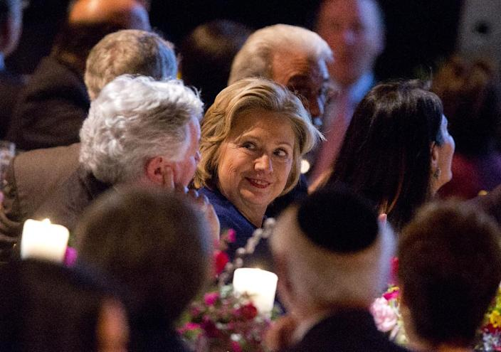 Former Secretary of State Hillary Rodham Clinton talks with other guests before receiving the American Jewish Congress' lifetime achievement award on Wednesday March 19, 2014, in New York. (AP Photo/Jin Lee)