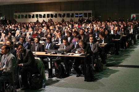 Delegates attend the 19th conference of the United Nations Framework Convention on Climate Change in Warsaw