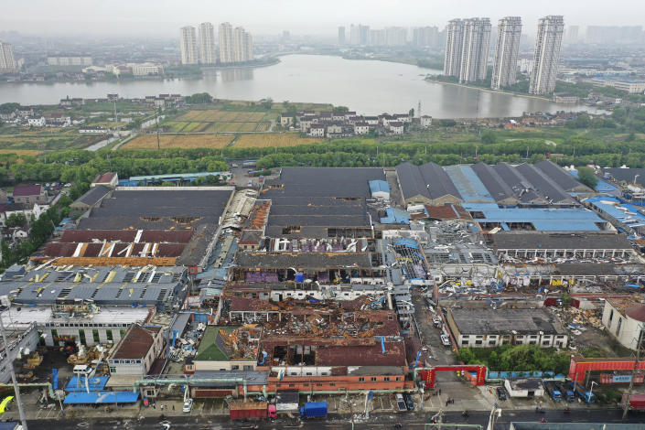 Damage to buildings from a reported tornado is seen in an aerial view in Shengze township in Suzhou in eastern China's Jiangsu Province, Saturday, May 15, 2021. Two tornadoes killed several people in central and eastern China and left hundreds of others injured, officials and state media reported Saturday. (Chinatopix via AP)
