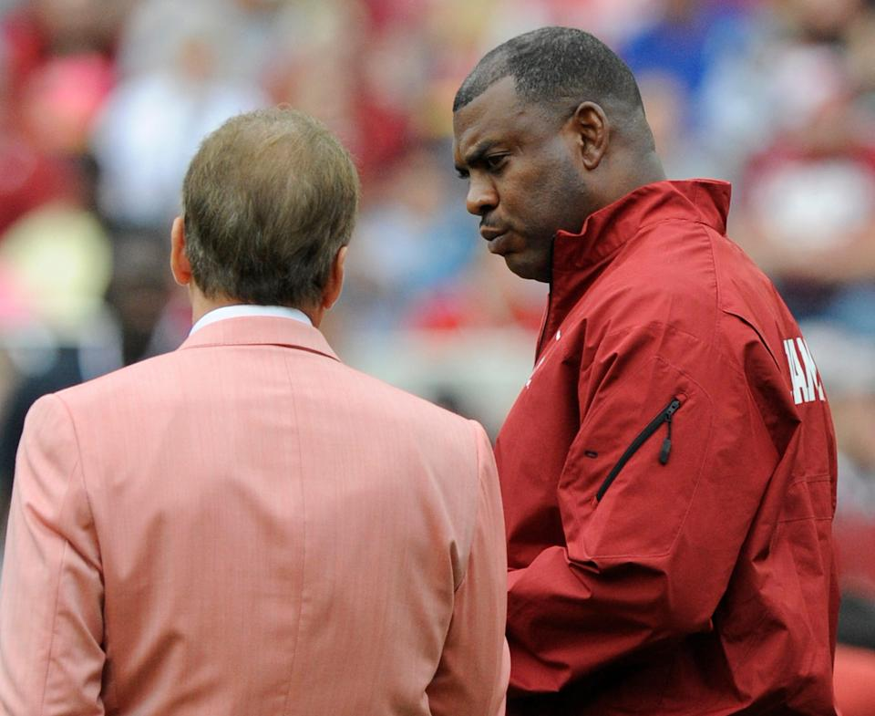Defensive backs coach Mel Tucker chats with head coach Nick Saban before the A-Day Spring Game at Bryant-Denny Stadium in Tuscaloosa, Ala. on Saturday April 18, 2015.