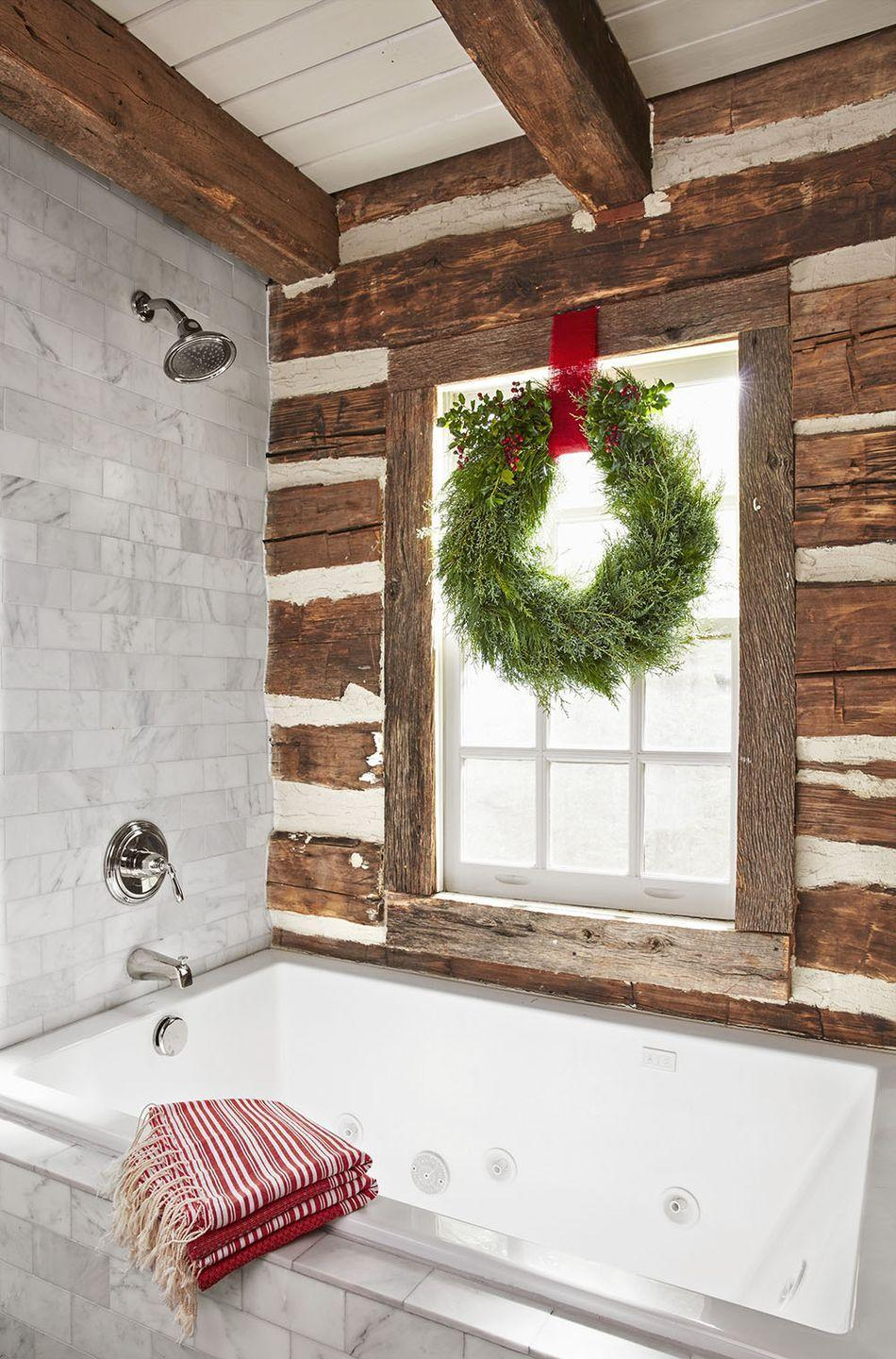 """<p>Make sure your windows in every room are covered—yes, we mean every room! A wreath in your bathroom will add a seasonal touch to the space.</p><p><a class=""""link rapid-noclick-resp"""" href=""""https://www.amazon.com/ITIsparkle-Solid-Double-Ribbon-Yards-Roll/dp/B07MN9YN7Y/?tag=syn-yahoo-20&ascsubtag=%5Bartid%7C10050.g.23343056%5Bsrc%7Cyahoo-us"""" rel=""""nofollow noopener"""" target=""""_blank"""" data-ylk=""""slk:SHOP RED RIBBON"""">SHOP RED RIBBON</a></p>"""