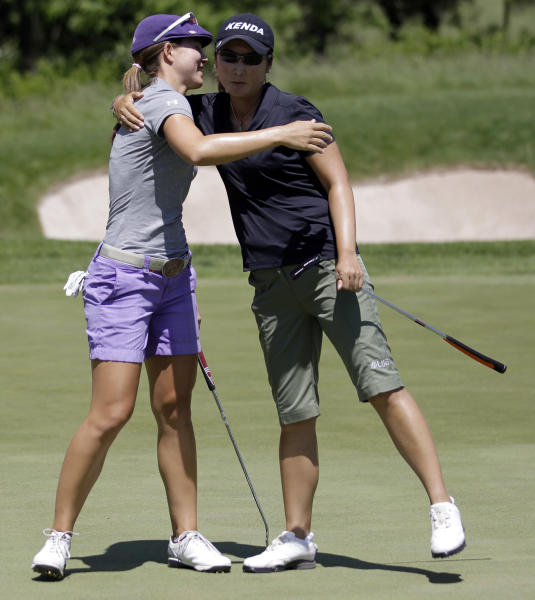 Candie Kung, right, of Taiwan, and Vicky Hurst hug on the 17th hole green after Kung won their semifinal round match in the LPGA Sybase Match Play Championship golf competition at Hamilton Farm Golf Club in Gladstone, N.J., Sunday, May 20, 2012. Kung won 2 and 1. (AP Photo/Julio Cortez)