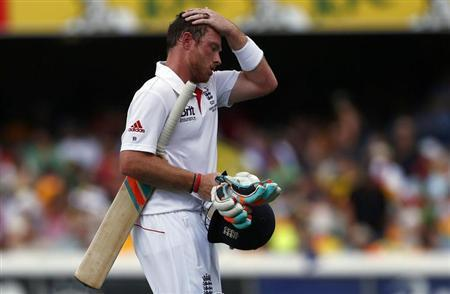 England's Ian Bell reacts as he walks off the field after his dismissal during the fourth day's play of their first Ashes cricket test match against Australia in Brisbane November 24, 2013. REUTERS/David Gray