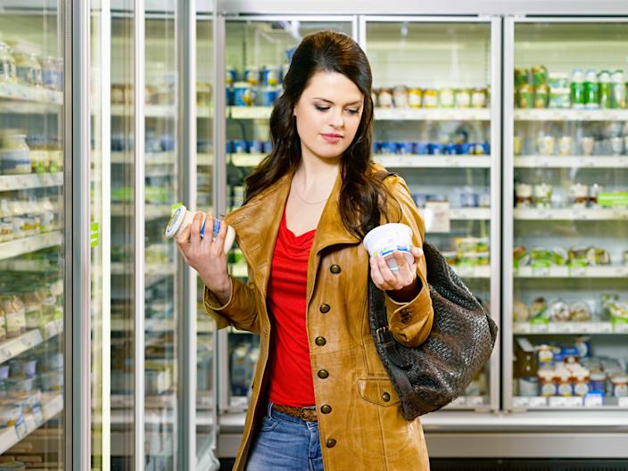 "The keto diet and the Atkins diet have different restrictions on what you can eat. <p class=""copyright""><a href=""https://www.gettyimages.com/detail/photo/woman-reading-product-packaging-in-supermarket-royalty-free-image/162716723?adppopup=true"" rel=""nofollow noopener"" target=""_blank"" data-ylk=""slk:Joos Mind/Getty Images"" class=""link rapid-noclick-resp"">Joos Mind/Getty Images</a></p>"