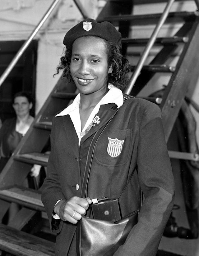 ** FILE ** U.S. Olympic team member Alice Coachman arrives from London on the U.S.S. Washington into New York City on Aug. 27, 1948. Coachman, the first black woman to win an Olympic gold medal, will be inducted into the U.S. Olympic Hall of Fame during a ceremony Thursday, July 1. in Chicago. (AP Photo/John Rooney, File)