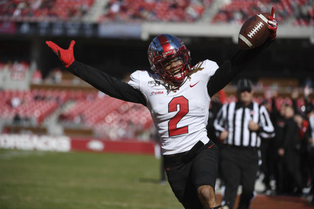 Western Kentucky receiver Jacquez Sloan celebrates as he scores as touchdown against Arkansas during the first half of an NCAA college football game, Saturday, Nov. 9, 2019 in Fayetteville, Ark. (AP Photo/Michael Woods)