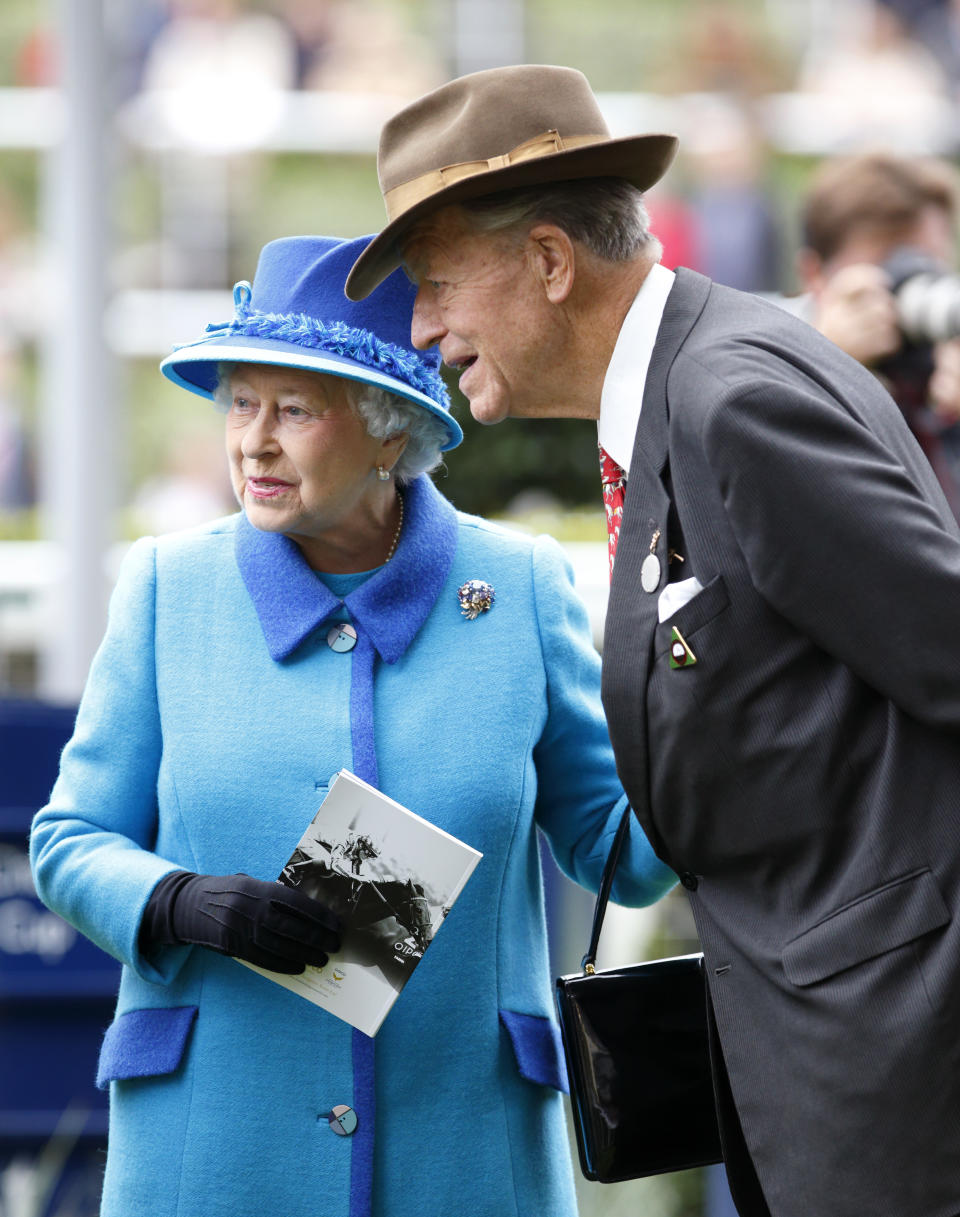 ASCOT, UNITED KINGDOM - OCTOBER 18: (EMBARGOED FOR PUBLICATION IN UK NEWSPAPERS UNTIL 48 HOURS AFTER CREATE DATE AND TIME) Queen Elizabeth II and Sir Michael Oswald attend the QIPCO British Champions Day at Ascot Racecourse on October 18, 2014 in Ascot, England. (Photo by Max Mumby/Indigo/Getty Images)