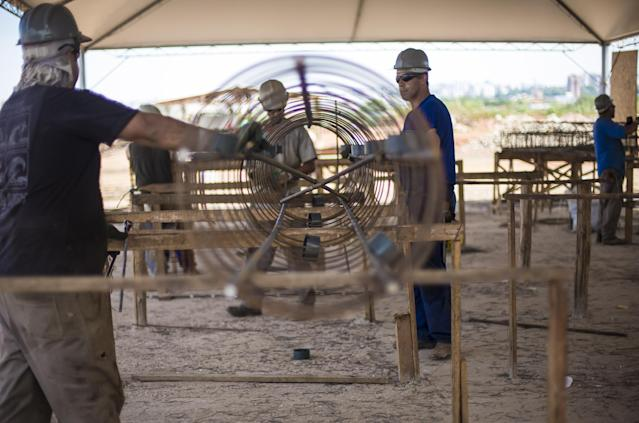 This Feb. 2014 photo released by Portal da Copa shows men working on the construction of the Salgado Filho International Airport in Porto Alegre, Brazil. Brazil's outdated airports were a problem long before the country was awarded the World Cup in 2007. Infrastructure experts say that Brazil has run out of time to meet its promise to fully expand and renovate airports that will serve hundreds of thousands of fans pouring into the country for the World Cup that starts in just two months. (AP Photo/Portal da Copa, Gabriel Heusi)