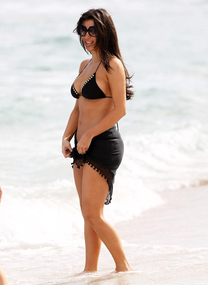 While in South Beach with sister Kourtney (again) and fellow reality star Kristin Cavallari in November 2008, Kim opted for a black bikini ... although she unfortunately covered up her bottom half with a sarong.